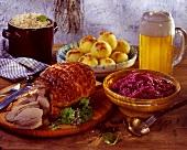 Roast pork with potato dumplings, cabbage, sauerkraut; Beer