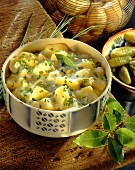 Sour potato casserole with gherkins, chives, bay leaf