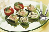 Tomato baskets, stuffed cucumbers & peppers on a plate
