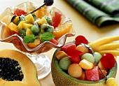 Fruit salad with lemon syrup; melon salad in melon half