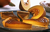 Pumpkin pie with slices of pumpkin on plate