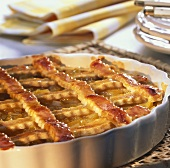 Crostata with peaches in a tart dish
