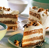Buttercream cake with walnut kernels