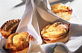 Mini meat pies on paper napkins