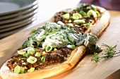 Turkish pizza with mince and cucumber sauce