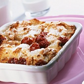 Cherry bread pudding in baking dish