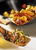 Sweet and sour pork and chop suey with beans on server