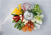 Plate of raw vegetables with herb quark dip