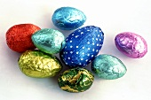 Chocolate eggs in coloured silver paper
