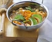 Asian vegetable soup with cucumber and carrots