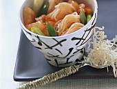 Sweet & sour noodle stir-fry; fried shredded dough on spoon