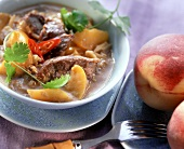 Duck curry with honey and peaches in sauce