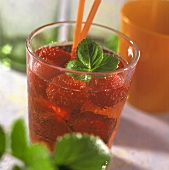 Strawberry punch with strawberry leaf in a glass