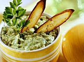 Root crisps with avocado dip and parsley