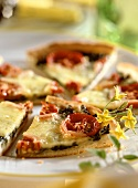 Spinach and tomato tart with cheese