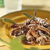 Finely chopped meat with creamed mushrooms and fresh sage