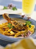 Chicken leg on oregano potatoes