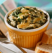 Gratin of spinach in a yellow bowl