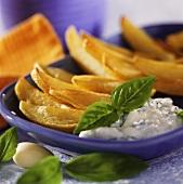 Fried potato wedges with basil yoghurt