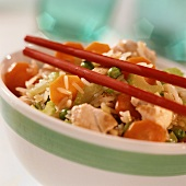 Fried vegetable rice with chicken breast fillet; red chopsticks