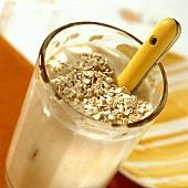 Banana soured milk with oat flakes in glass