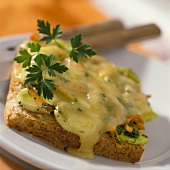 Raclette and vegetables on toast with parsley