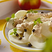 Apple carpaccio with horseradish dressing, capers and herbs