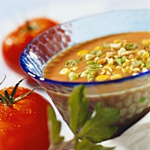 Tomato soup with sweetcorn, peanuts and spring onions