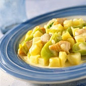 Potato and fish ragout with leeks on plate
