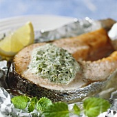 Salmon cutlet with herb mousse on aluminium foil