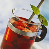 Vitamin-rich berry punch in glass with mint leaves
