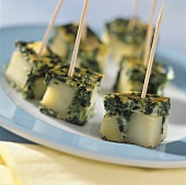 Spinach and tortilla cubes on toothpicks