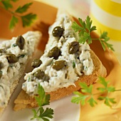 Toast triangles with trout dip and capers