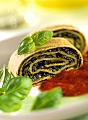 Spinach strudel with tomato sauce and basil