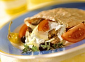Pitta bread with gyros, yoghurt and vegetables