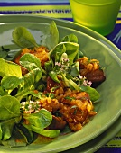 Poultry liver on corn salad with fresh thyme