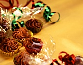 Chocolates in paper cases and cellophane paper
