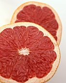 Two pink grapefruit halves