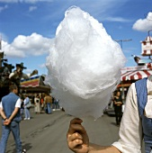 Woman holding candyfloss at Oktoberfest