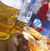 Two tankards and two pretzels on a table at October Festival