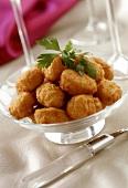 Deep-fried shrimp balls in a glass bowl