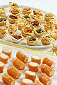 Salmon rolls and filled filo pastry snacks