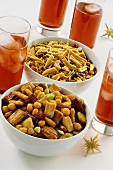 Asian nut mixtures in bowls; Campari with ice