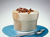 Ice cream souffle with grated chocolate in a glass dish