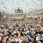 Crowd scene in a beer tent at Oktoberfest