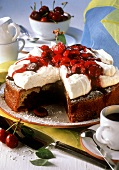 Cherry quark cake with icing sugar, a piece cut