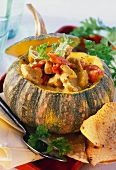 Pumpkin curry with chicken & peppers in hollowed-out pumpkin