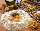 Home-made pasta & ingredients (flour, eggs, olive oil)