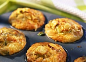 Four leek and cheese muffins in muffin tin