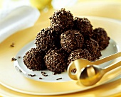 Rum truffles with chocolate vermicelli on plate
